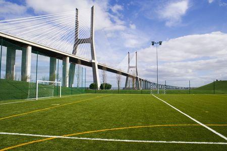 An empty soccer field under a bridge Stock Photo - 788125