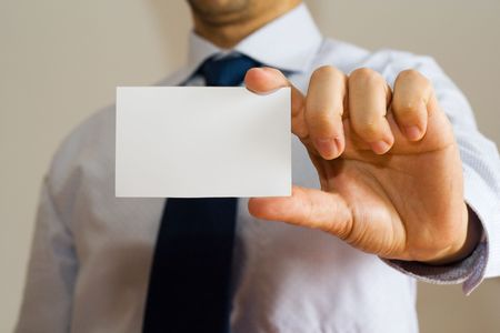 Business man holding a blank name card photo