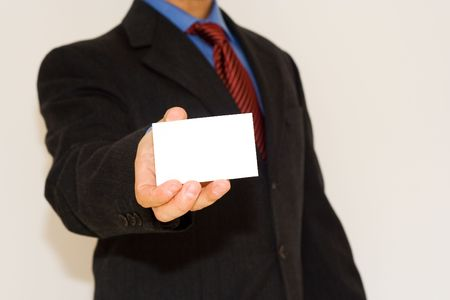 business man holding a white card (focus on the card) photo