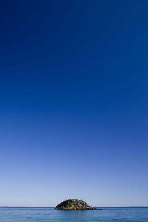 to soak: A small lonely island and a big blue sky Stock Photo