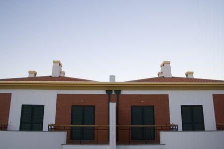 investment real state: un detalle de dos casas en un pueblo dispuesto a vender  Foto de archivo