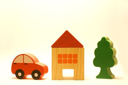 A car, a house and a tree in a white background photo