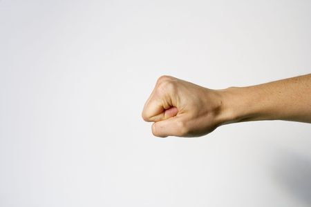 closed fist: A closed fist of a woman in a white background Stock Photo