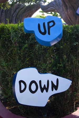 A funny signs indicating with word Up and Down photo