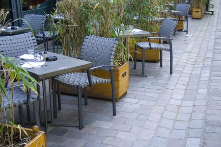 A perspective of chairs and tables of a restaurant photo