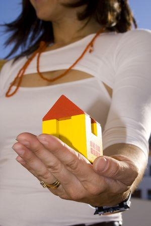 Proudly pretenting my new house  (focus on the house) Stock Photo - 963782