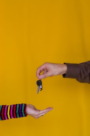 a bussiness man passing the keys to a young woman Stock Photo - 970689