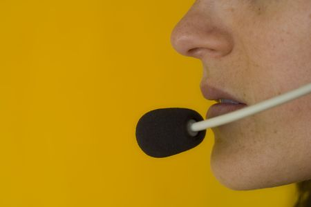 A closeup of the headseat and mouth of a call operator Stock Photo - 970690