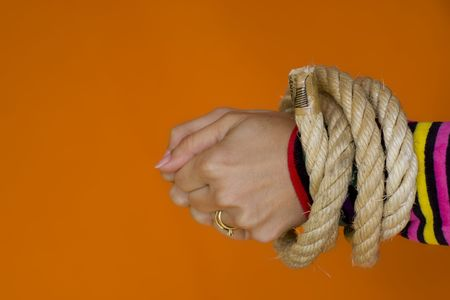 mislead: Woman hands tiedup with a strong rope