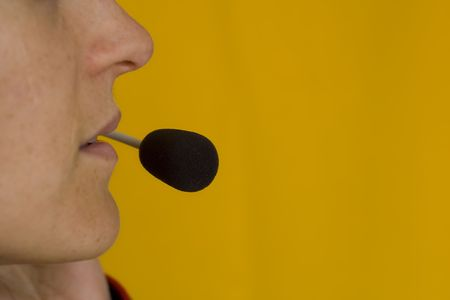 A closeup of the headseat and mouth of a call operator Stock Photo - 970694