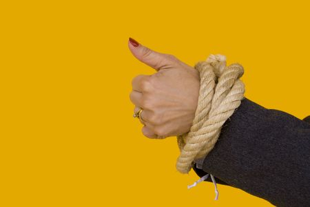 a businesswoman with her hands tied for a corporate crime photo