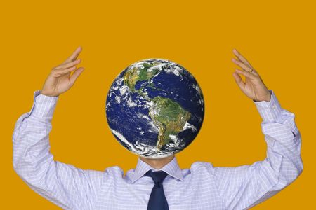 businessman carrying a globe: a businessman with a world face between his hands
