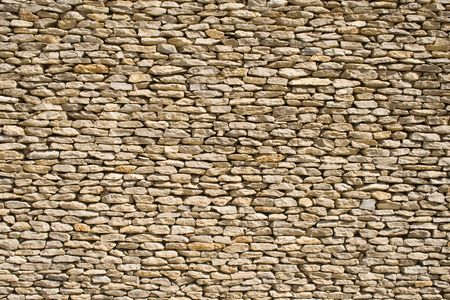inorganic: the detail of a wall made of stones Stock Photo