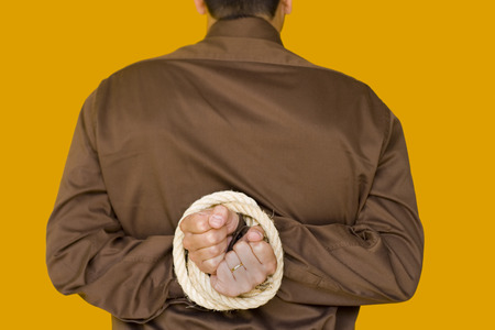 tiedup: a bussiness man with his hands tiedup (focus on the hands) Stock Photo