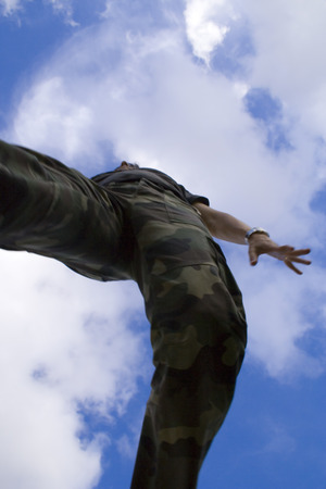 a perspective of a boy jumping (motion blur) photo