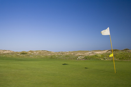 a detail of a hole and flag in a golf course Stock Photo - 1577097