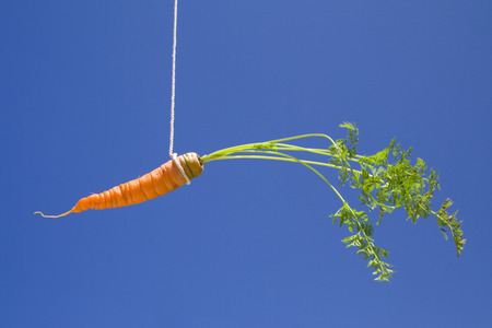 incentives: a carrot in the sky, like a bait Stock Photo
