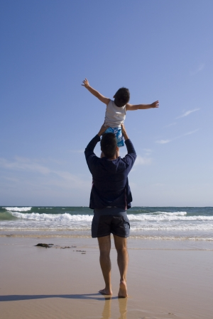 Father and son enjoying life at the beach Stock Photo
