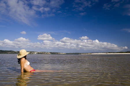 wather: woman on the wather refreshing from a hot summer Stock Photo