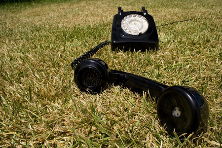 an old telephone on a green grass Stock Photo - 1577210