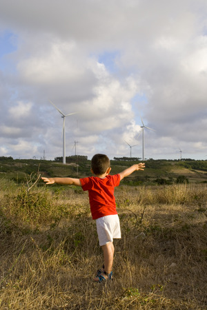 a kid showing that he loves ecological power sources photo