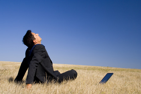 young businessman Making peace with nature photo