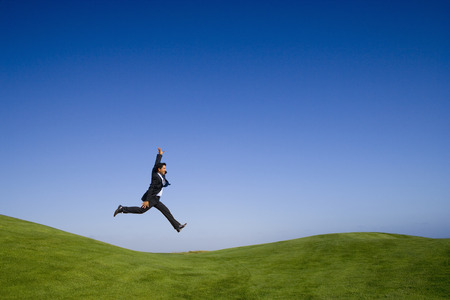 businessman feeling the joy of a beautiful landscape photo