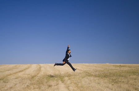 businessman taking the giant step, embracing nature photo