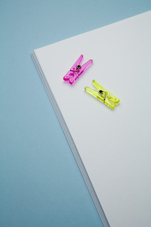 blank paper for writing with two clothespin photo