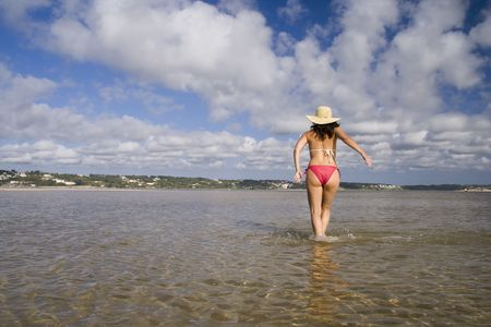 woman with a hat enjoying the beach Stock Photo - 1769977