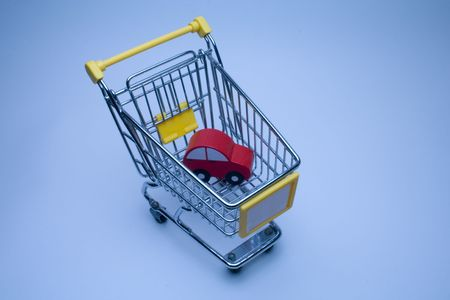 a shopping basket with a car photo