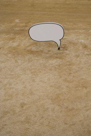 dialog baloon: a cartoon balloon on a beach Stock Photo