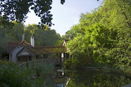 House by the lake in an England park photo