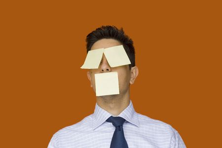 businessman with post-it notes on his face photo