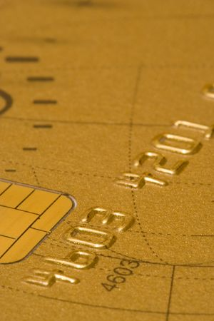 expires: a macro detail of a gold credit card (soft focus) Stock Photo