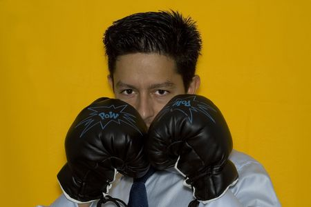 aggressive businessman ready to punch everyone photo