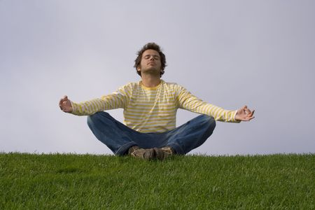 young man relaxing with yoga in a park photo