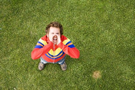 A high view perspective of a young man screaming ans shouting out loud Stock Photo - 2144282