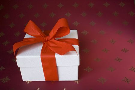 closed ribbon: a white box with a red ribbon as a christmas present