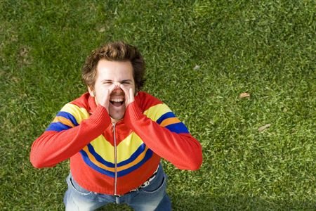 loudness: A high view perspective of a young man screaming ans shouting out loud Stock Photo