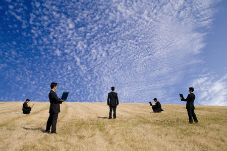 businessman working in a field making a teamwork with the nature Stock Photo - 2323812