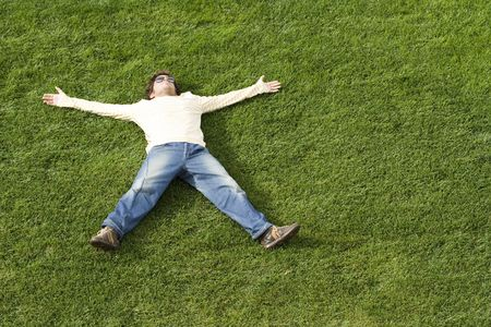 young man enjoying nature sleeping on the grass Stock Photo - 2360571