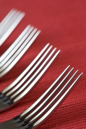 symetry: a fork perspective with a red background (soft and selective focus)