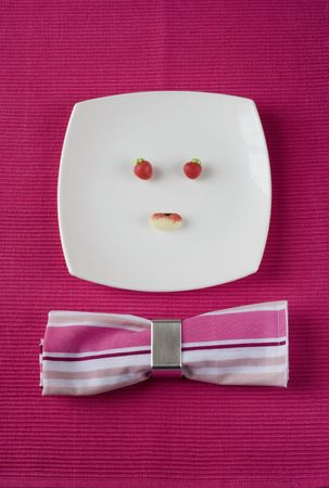starvation: a plate with candys making a funny face Stock Photo