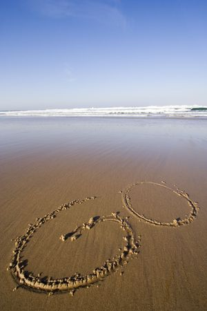 the word GO in the sand, GO Travel photo