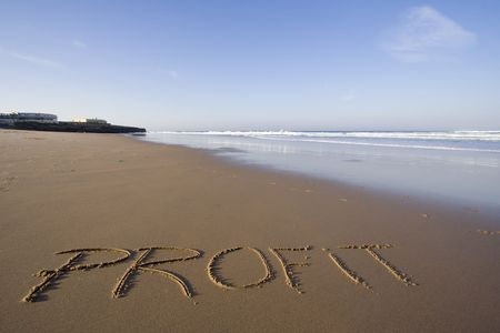 the word profit in the sand photo