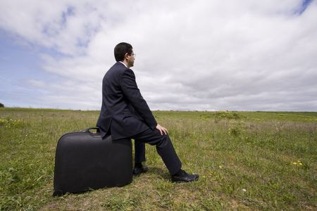 business traveler, businessman sit in his baggage  photo