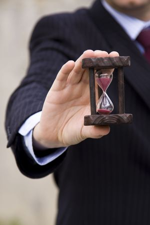 a businessman showing how to save time (selective and soft focus) photo