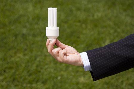 a businessman holding a economic lamp, conceptual idea and creativity photo