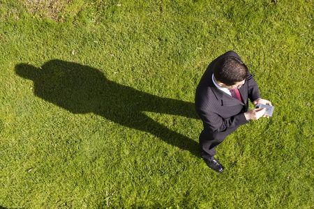 above view of a businessman working with a palmtop (focus on the device) photo